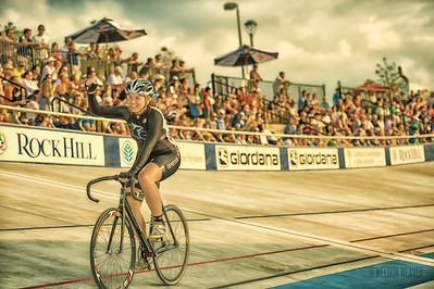 Kristen Meshburg podiums the scratch race of the 2012 National Omnium Championship in Rock Hill.  Photo by Weldon Weaver.