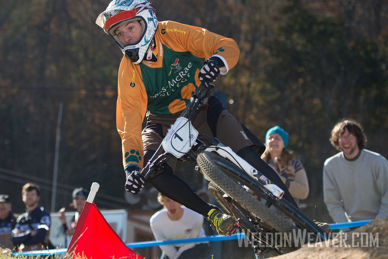 Kerry Warner easily won the Division 1 omnium. This photo is from the dual slalom race.  USA Cycling Collegiate Mountain Bike National Championships<br /> Oct. 27 - Beech Mountain, NC.  Photo by Weldon Weaver.   Select and share.