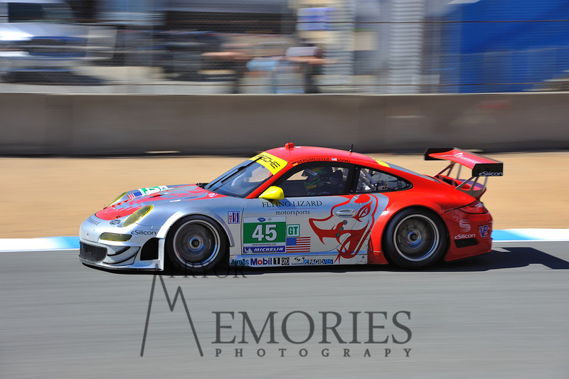 2011: Joerg Bergmeister and Patrick Long driving the Flying Lizard Motorsports Porshce 911 GT3 RSR at the Mazda Raceway Laguna Seca American Le Mans series race.
