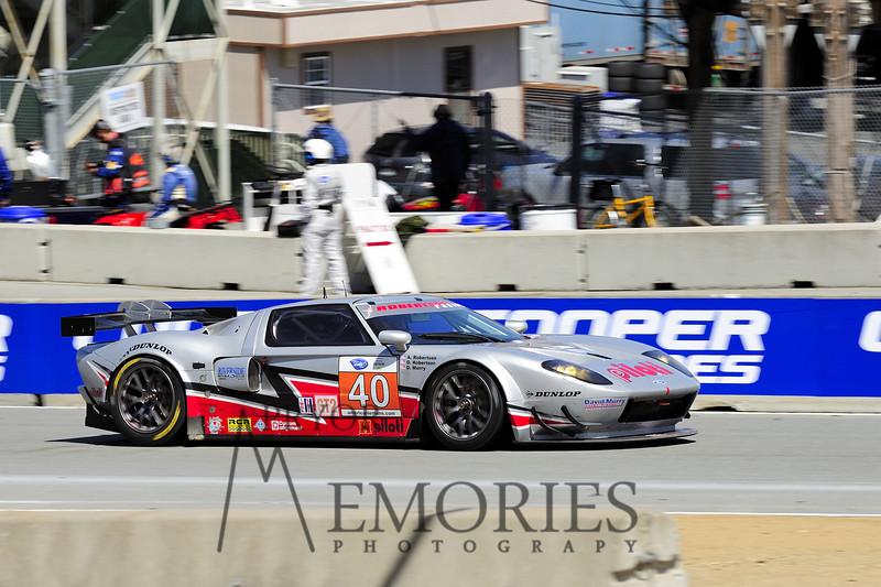 2010: David Robertson (owner), Andrea Robertson (owner) and David Murry (in car) driving the Roberstson Racing Doran-Ford GT at the Mazda Raceway Laguna Seca American Le Mans series race.