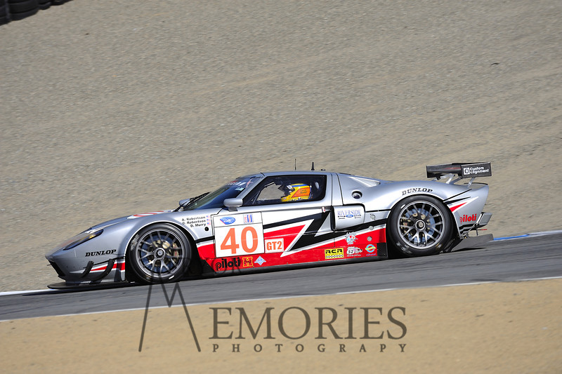 2010: David Robertson (owner), Andrea Robertson (owner) and David Murry (in car) driving the Roberstson Racing Doran-Ford GT at the Mazda Raceway Laguna Seca American Le Mans series race.