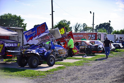 Crews work in the paddock at Sandusky Speedway