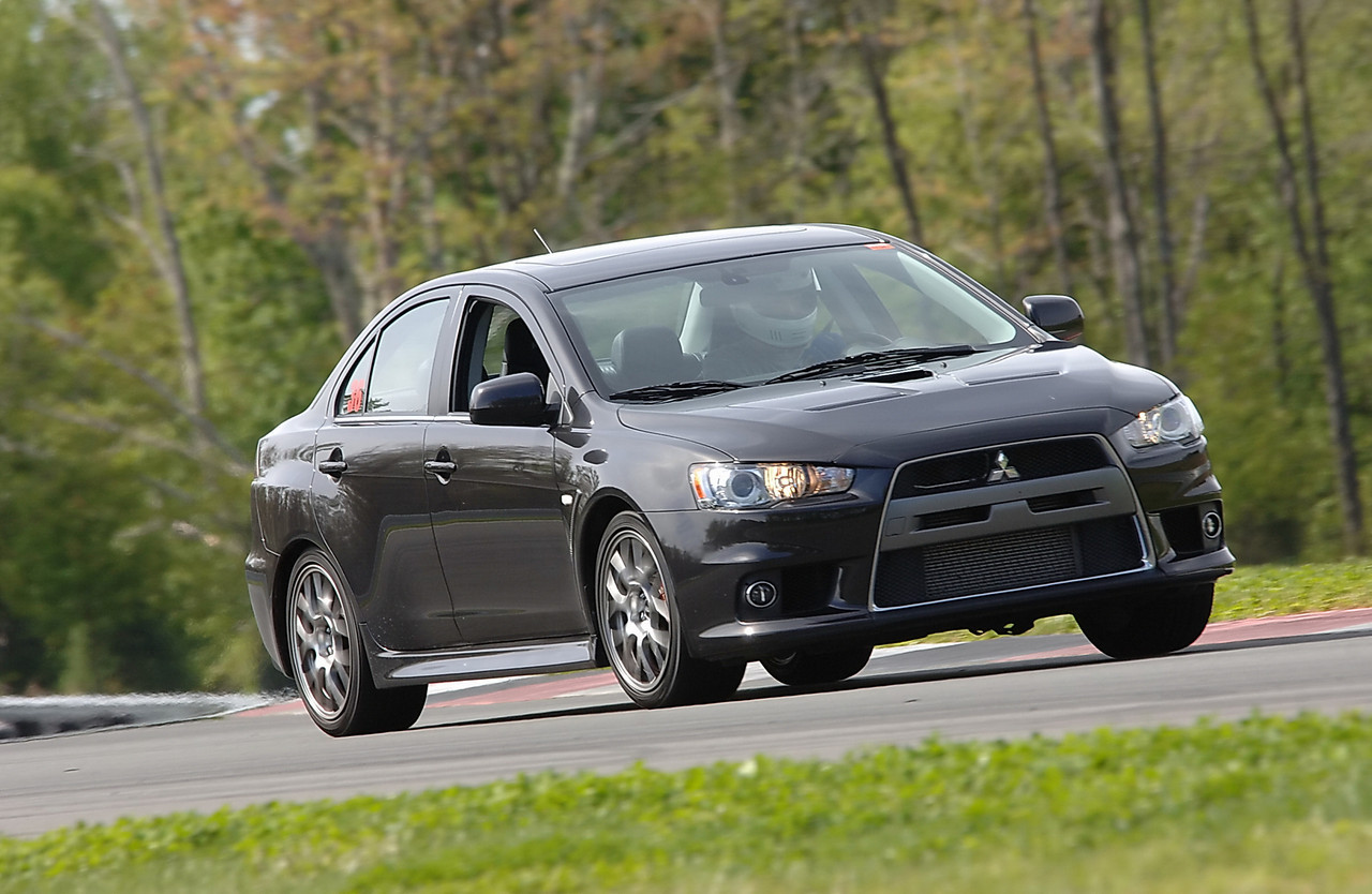 Driving the Mitsubishi Lancer EVO MR at Monticello Motor Club, May 2010. Car was fun but had overheating issues with the dual-clutch tranny and the engine. (Photo by Newlin Keene - TrackTime photos)