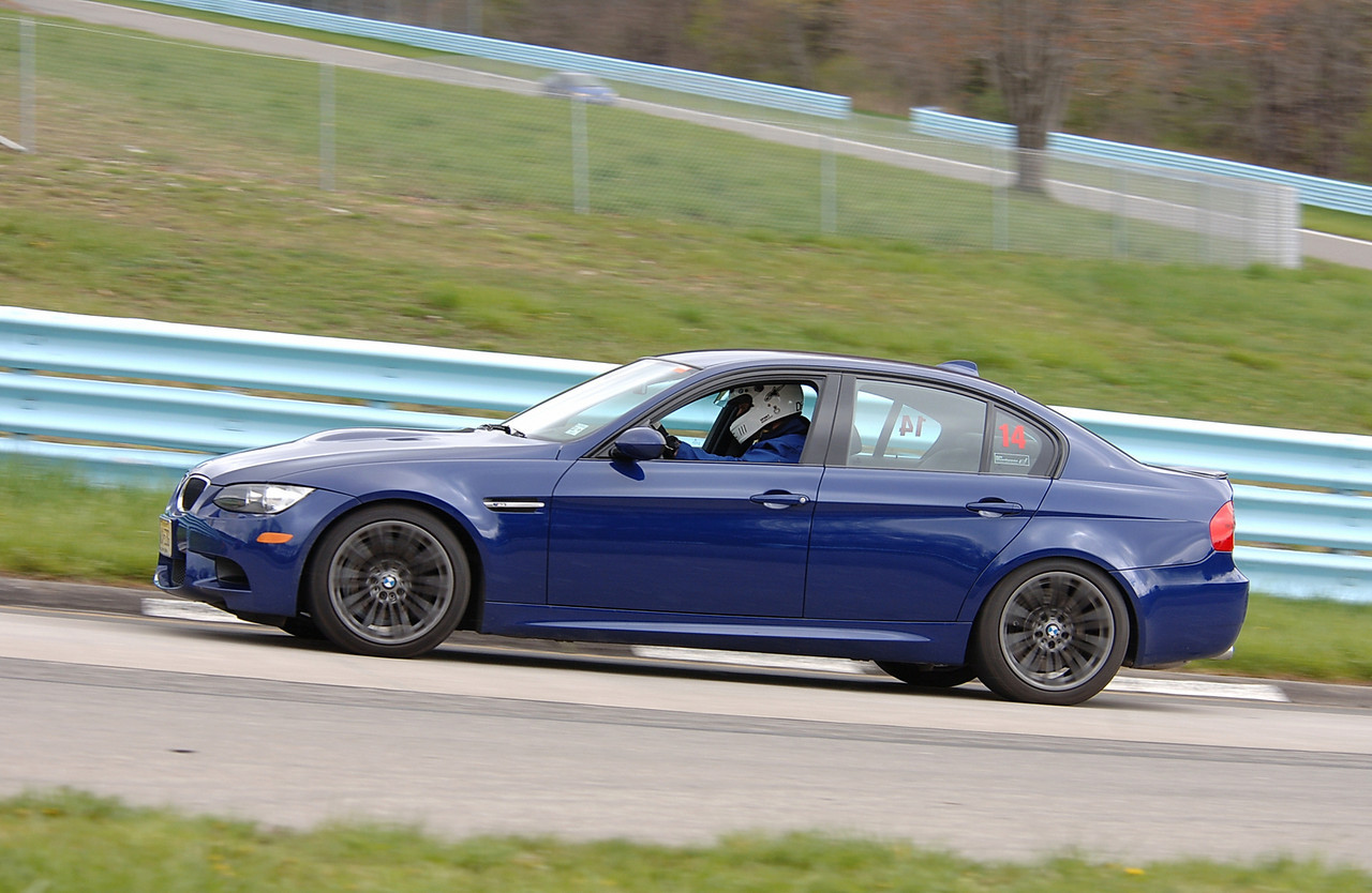 M3 sedan at Watkins Glen, April 2010. It was 37 degrees and snow flurries on the day I drove this. This was taken in one of the few sessions when it wasn't snowing. Awesome car. (Photo by Newlin Keene - Track Time Photos)