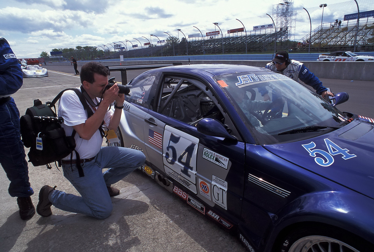 Shooting the Bell Motorsport BMW M3 at Watkins Glen in 2001. This car had a V8 installed from the E39 M5 and was one of the fastest cars in the Grand Am Series that year. The article I wrote and photographed on this car was published in Bimmer magazine. (Brian Hollingsworth photo)