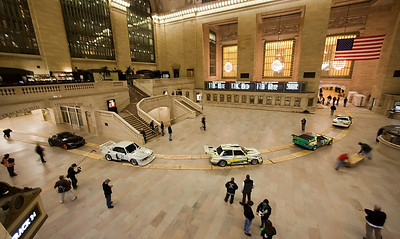 Shooting the installation of the BMW Art Cars in Grand Central Terminal in New York, March 2009.(Jim Sulley/newscast)