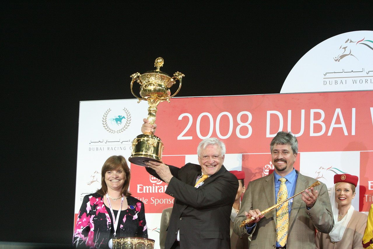 "IMG_0291.JPG<br /> Curlin's owner Jess Jackson, center, accompanied trainer, Steve Asmussenholds up the trophy <br /> after winning the ""Dubai World Cup"" race in Dubai, United Arab Emirates, Saturday March 2"