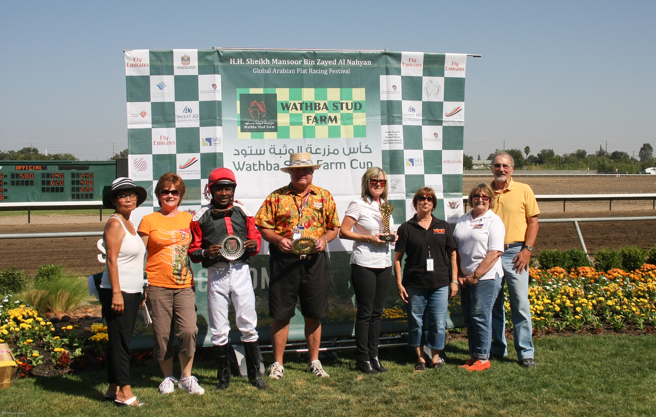 Jockey Barrington Harvey accepts the Wathba Farm Cup award