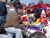 Tyler church gets instructions from Bob East. Tyler lives right here in Hickory, but has never been on the track before
