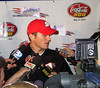 Kasey surrounded by the press