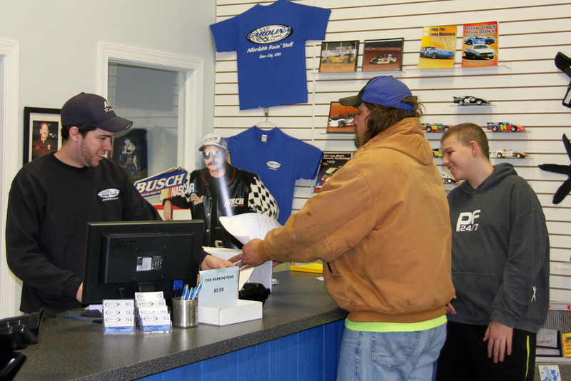 Erick makes a sale to local racers