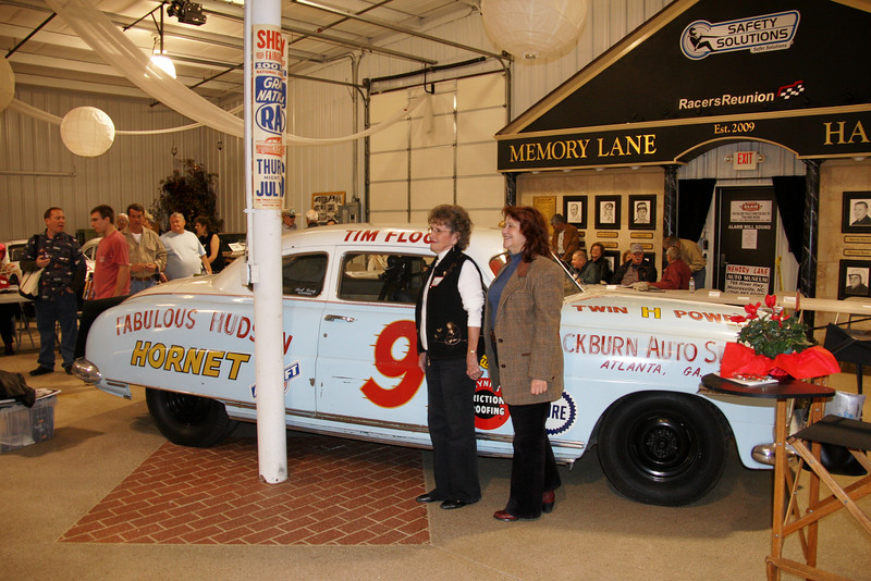 Francis Flocj and Deb Williams with Tim Flock's Hudson Hornet from the early 50's