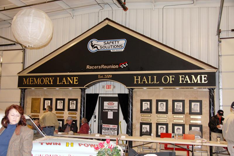 NASCAR writer Deb Williams and the Memory Lane Hall of Fame wall