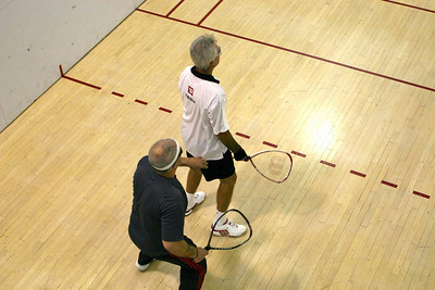 Jay Wisthoff (White Shirt) and Warren Bailey do battle in the Men's 50+ quarter final match.
