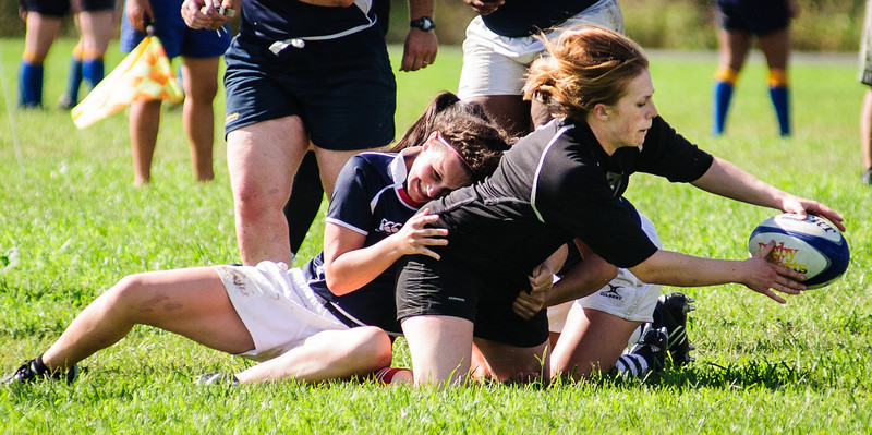 Two UConn players try to bring down Radcliffe team president Sarah MacVicar (H '13) in the Beantown finals on September 9, 2012. Photo by Lynne Skilken.