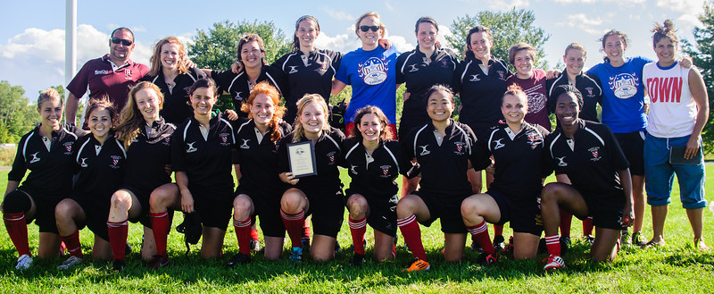 The Harvard Radcliffe rugby team with head coach Bryan Hamlin. Radcliffe won the Beantown College Tournament on September 9, 2012  at U Mass Amherst. Women's rugby will become a varsity sport at Harvard in 2013, a first for the Ivy League. Photo Lynne Skilken.