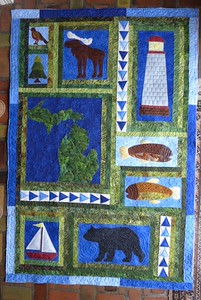 Michigan memories quilt on right by the small group - Quilters Anonymous.
