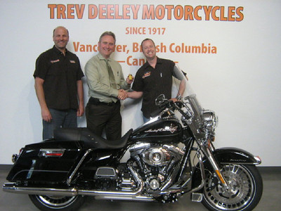 2011 RAFFLE WINNER Ride To Live Motorcycle Raffle MAY 2011 Bill Pake (in center) from Delta BC 2011 Harley Davidson Touring Road King supplied by Trev Deeley Motorcycles