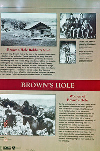 A sign describing the history of the area. Particularly Brown's Hole. Butch Cassidy and the Sundance Kid spent a lot of time in the area.