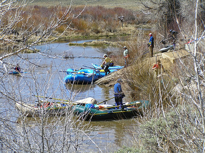 Rafts and kayaks, North Platte River, CO April 16, 2006.   Packing the rafts on a nice sunny spring day.