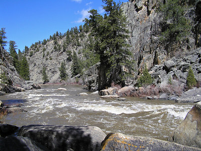 OK.  First set of really nice rapids.  Also, I had to turn around here (or, climb up a long ways).  You can't see it from this picture, but just to the left is a sheer cliff that the river runs up against.  Anyway, I took a lot of photos of this set of rapids.  Did not get to see anyone go down them. Looking down river.