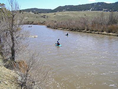Kayakers heading downriver and having fun.