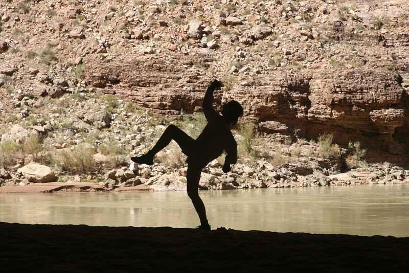 Sherry recreating a famous CD-cover pose.  Inside Redwall Cavern makes silhouette photos looking out towards the river.