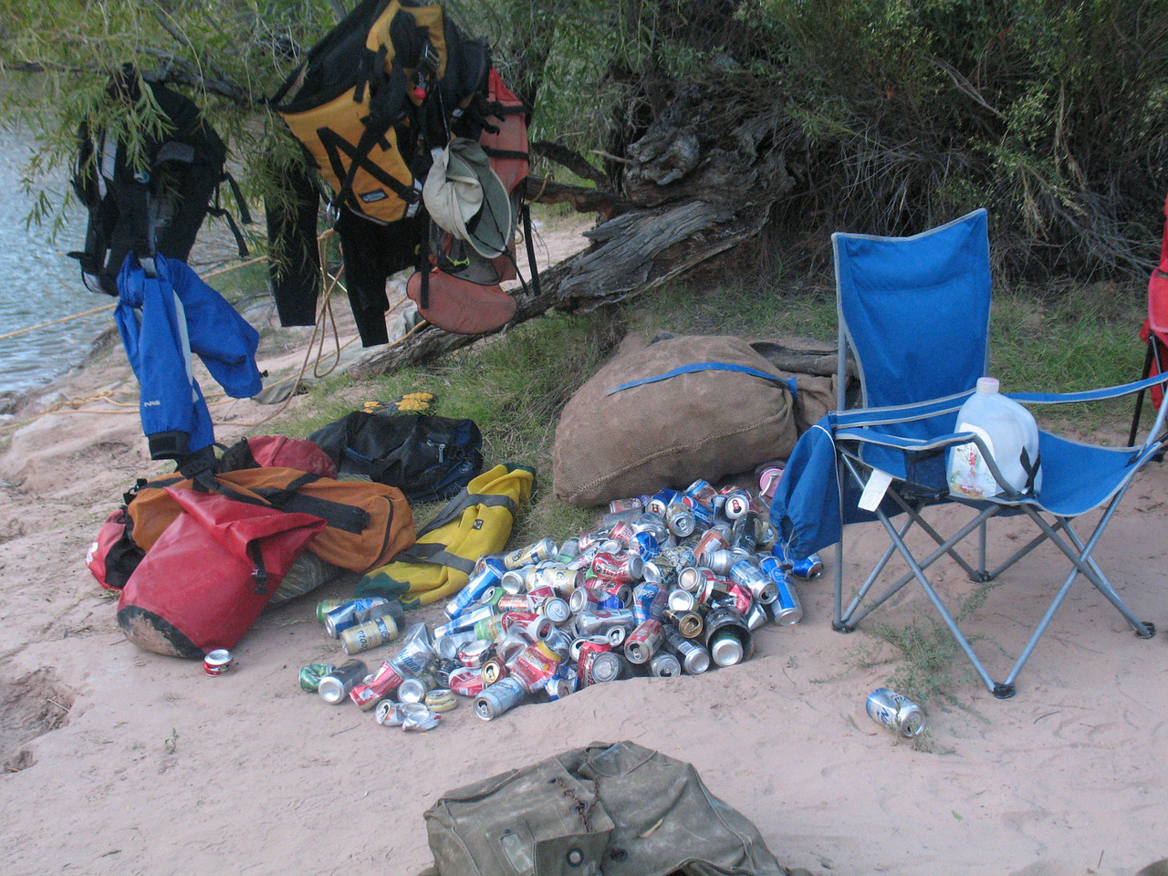 At camp, as beer is drunk, cans are tossed in a pile.  Before we launch the next day, cans are smashed, and go into the burlap bag, behind.  Everything must be packed out.  Actually, this was a layover camp, so this pile represents 2 days worth of what 14 people drank.