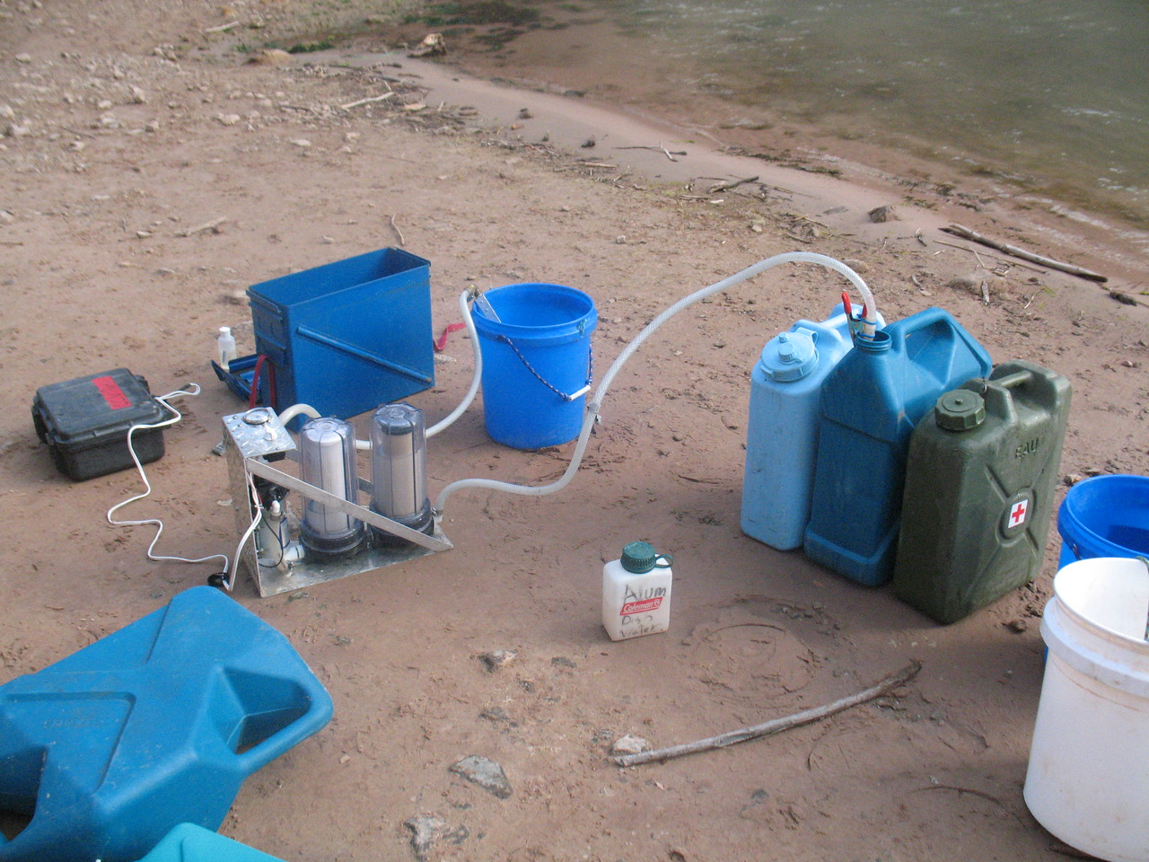 "We must carry all our drinking water.  When we run out, we filter more.  Wick designed the ""power"" filtering system.  A large battery pumps a bucket of river water through 2 filters, which go into our water tanks.  Alum is used first to settle any silt to the bottom of the bucket."