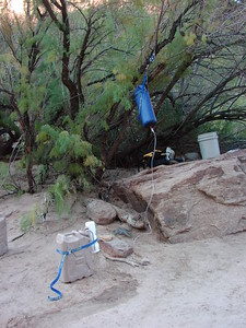 Here we are able to hang the water bag from a tree.