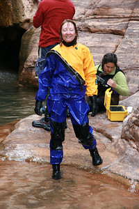 "This is my rented dry suit.  The rubber ""socks"" are connected to the legs, so there is no way water can get in.  There are rubber gaskets around the neck and wrists.  Once you are wearing it, you must ""burp"" it, in order to be able to put your life vest on over it."