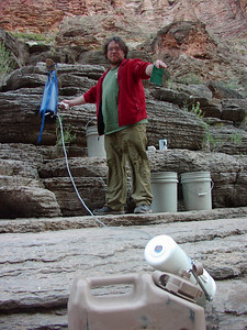 John is our water czar.  He has rigged a piece of wood in the rock to hang the water from, when no tree is available.