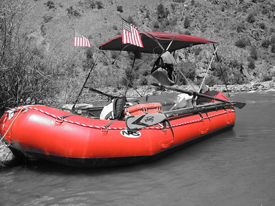 Boating - Mike's new Red Raft.  All our rafts wore US Flags for 4th of July.  Photo by Joe B.