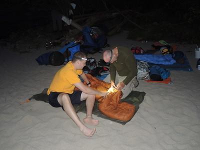 Activities - Joe B and Joe C work together fixing the zipper on Joe B's sleeping bag.  Photo by Sherry.