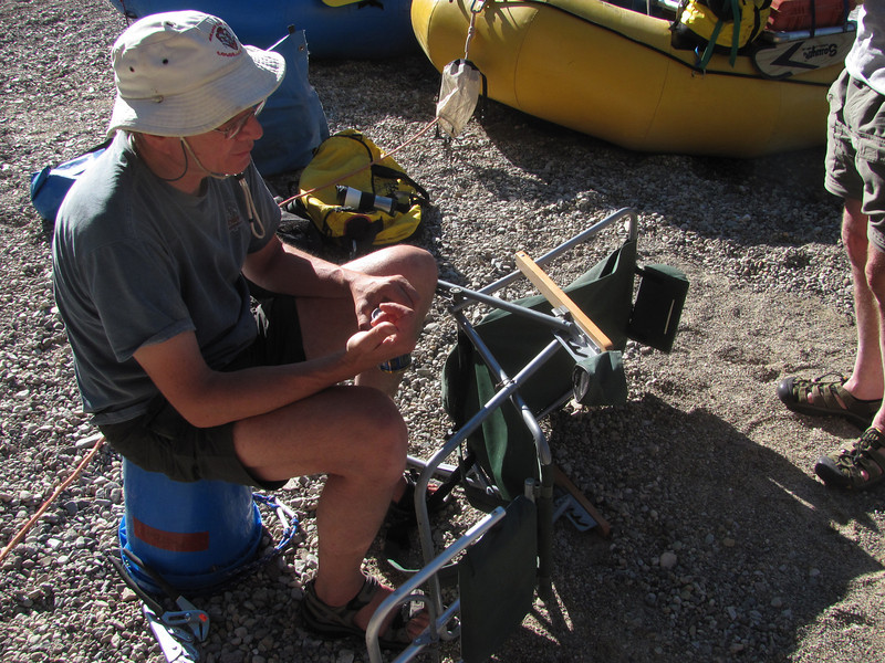 Joe fixing his chair