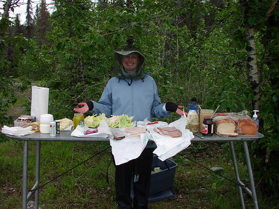 Kelsi has our first lunch ready - and fends off mosquitos, too!