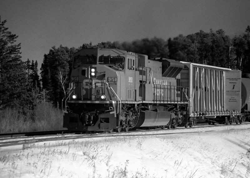 CP 9158 heading through Barclay Ontario (photo taken December 2002, processed February 2009). I did not develop the film so I did not place this image in the main black and white gallery. <br /> <br /> Minolta Maxxum 7 loaded with Kodak TMY.