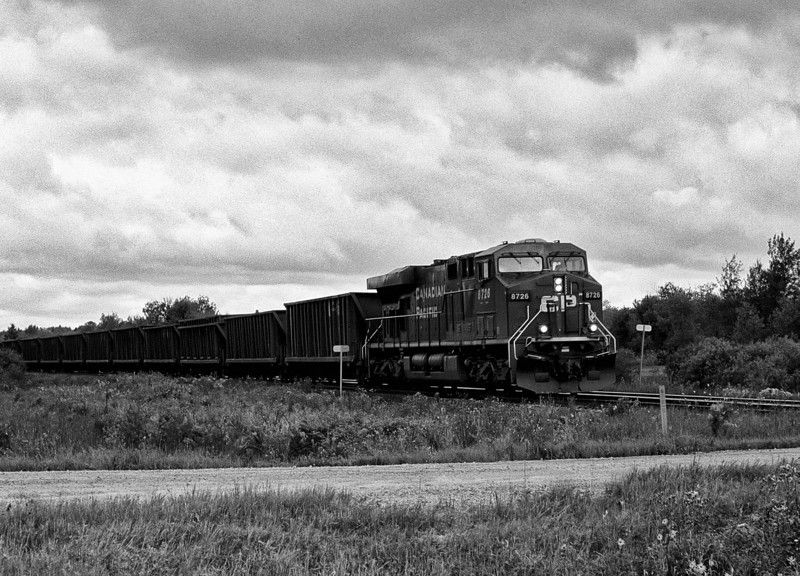 CP 8726 heading east through Barclay Ontario with a load of coal.<br /> <br /> Pentax K1000 SE loaded with T-Max 100 developed in Kodak D76 for 6.45 minutes at 22C. I had a Pentax-M 50mm F2 lens on the camera.