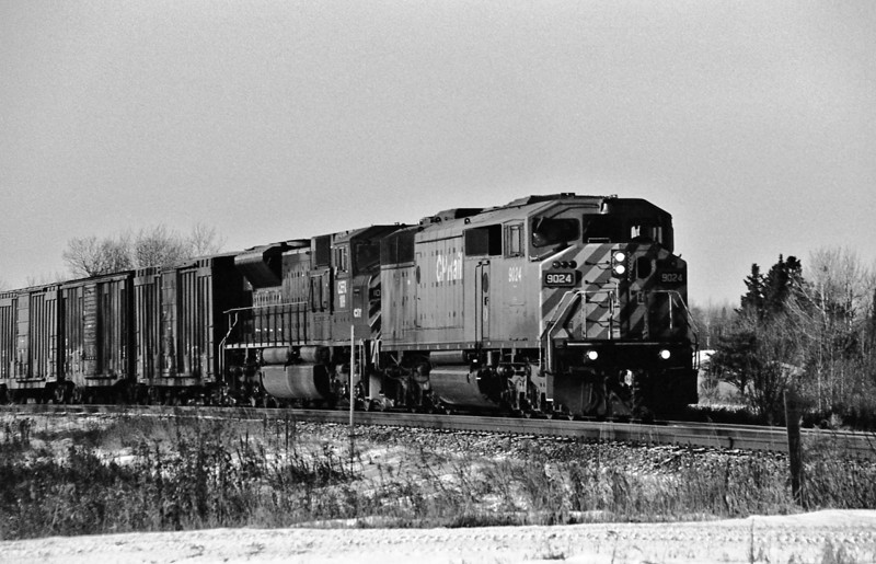 CP 9024 and CEFX 109 heading east through Barlcay Ontario.<br /> <br /> Photo taken using Ilford HP5+ black and white film that I developed with Kodak HC-110 at 20C for 5 minutes. Image taken with a Minolta Maxxum 7 film camera with a Sigma 28-300mm lens.