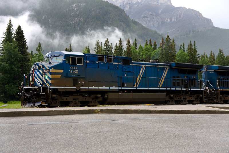 CEFX 1030 and 1055 sitting at the station in Banff, Alberta during a light rain.