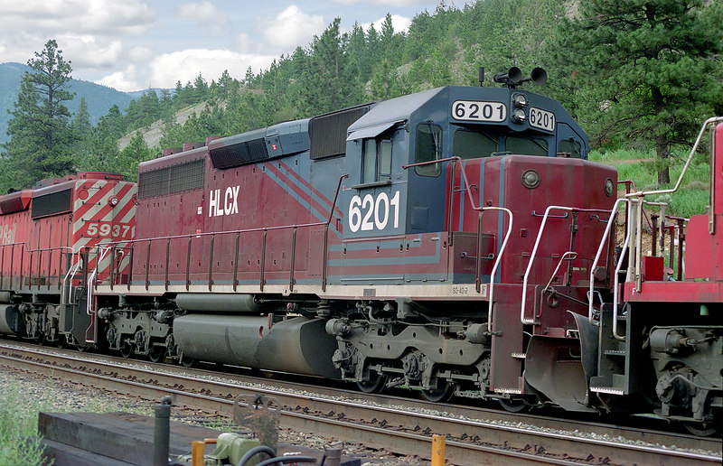 A HLCX SD-40-2 behind a CP SD-40-2 5836 and 5937, sits in Lytton, BC. The nose of the third unit, is a SOO SD-60.