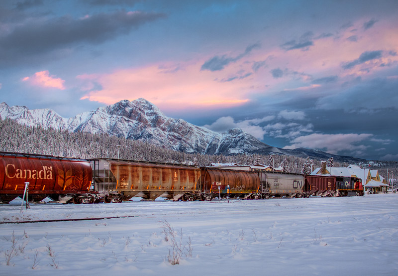 Eastbound Grain Empties A snowy November morning blankets the CN yard, old Jasper Station, and Pyramid Mountain  2011