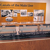 "A model of the ""Lou Ann"" sits on the rail cars in a display"