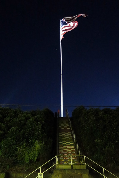 On the hillside above the Inclined Plane is a magnificent 30' x 60' is the Centennial American flag. It flies on a 125' flagpole, putting the flag at the highest point above the valley. This flag is one of the largest flags in the United States. It can be seen for miles-- from almost any point in the valley. It is illuminated at night and is only lowered during severe weather.