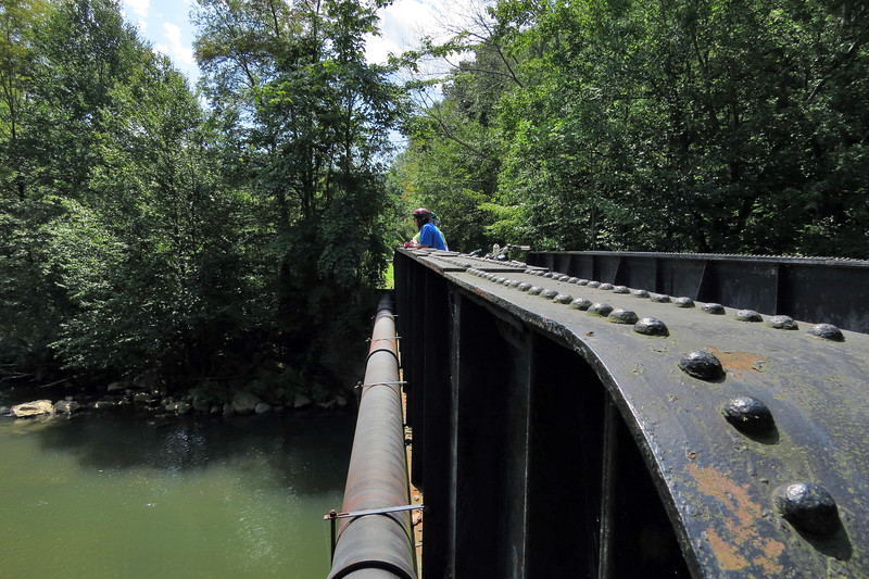 Peggy Eyler, Beth Arsenault and Mary Menderlein take in the view from a railroad bridge over the South Branch of Blacklick Creek on the Ghost Town Rail Trail