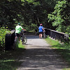 Beth Arsenault, Peggy Eyler and Mary Menderlein crossing a Ebensburg and Black Lick Railroad bridge over the South Branch of Blacklick Creek now used by the Ghost Town Rail Trail