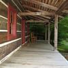 Log House Homestead B&B front porch