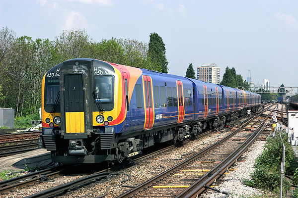 450544 and 450558, Clapham Junction 20/4/2011 2U36 1253 Windsor and Eton Riverside-London Waterloo