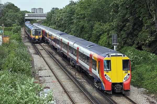 8019, 8015 and 450044, Feltham 22/6/2006 8019 and 8015: 1C51 1650 London Waterloo-Reading 450044: 2S52 1633 Weybridge-London Waterloo