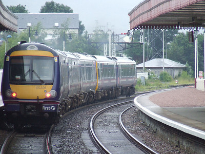170396 at the rear of the Class 158/170 combi departing for Inverness